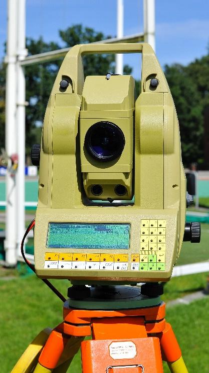 Afbeelding met gras, landmeterniveau, automaat  Automatisch gegenereerde beschrijving